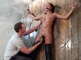 Smooth pussy poking with sex toys during torture for Mia Manarote