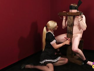 Naughty blonde maid Mira Sunset gives a blowjob to a slave