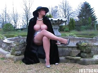 Sexy babe Danica Collins loves rubbing her pussy in the backyard